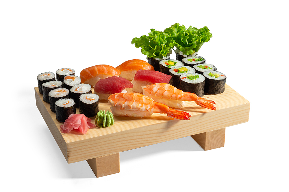 Sushi set and sushi roll on wooden board isolated on white background